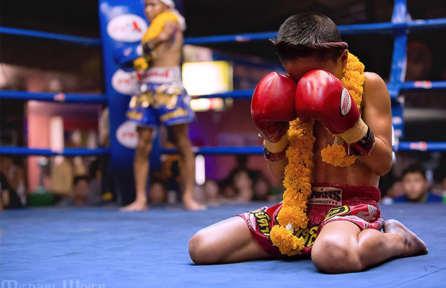 A Muay Thai fighter performing the Wai Khru before his fight.