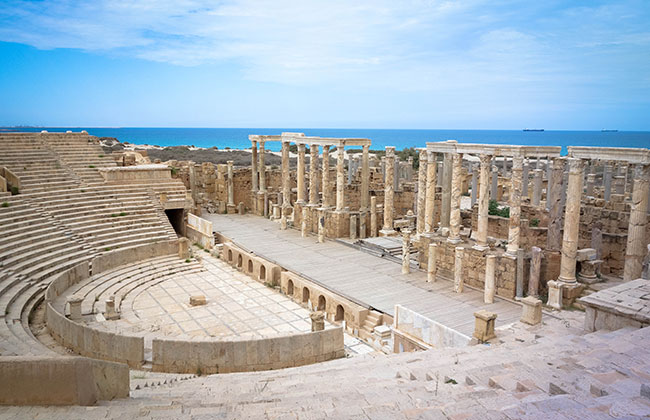 The theater at Leptis Magna with the Mediterranean behind it